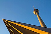 Fernsehturm, Berlin's tall-rising TV tower, sits at Alexanderplatz in eastern Berlin. The imposing structure was erected at the height of the Cold War by the communist authorities, and it towers over the entire capital. Soon after its construction, West B
