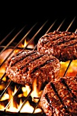 Flame grilled burger on a bbq