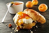 Traditional British scones with clotted cream and apricot jam
