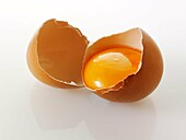 Cracked open fresh Burford Brown free range organic Eggs
