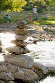 Stack of stones beside Dreisam river bank, Freiburg im Breisgau, Baden-Wurttemberg, Germany