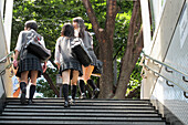 Japanese Schoolchildren in Uniform, Their Satchels Slung Over Their Shoulders, Leaving the Metro, Tokyo, Japan