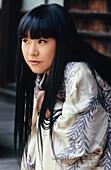 Portrait of a Young Japanese Woman Wearing a Light Kimono, Kyoto, Japan, Asia