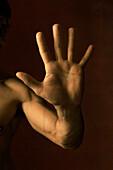 Man's hand raised making stop gesture