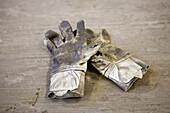 Pair of worn work gloves