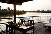 Sailing on the Mekong River on a wooden tourist boat, Mekong River Delta Region, Vietnam