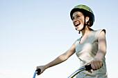 Teen girl riding bicycle