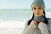 Teen girl at the beach on chilly day, portrait
