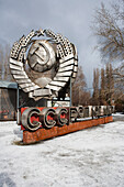 Discarded CCCP emblem in Muzeon Park of Arts, Moscow, Russia