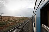 Uzbekistan, passenger train traveling through the ancient Silk Road