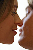 Man and woman about to kiss, close-up