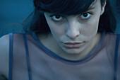 Woman looking at camera, head and shoulders, close-up