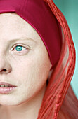 Young woman wearing headscarf, close-up