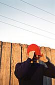 Man adjusting hat