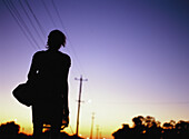 Silhouette of woman at twilight
