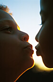 Two children about to kiss, extreme close-up