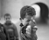Child pointing gun, b&w