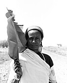 Ethiopian Woman in Robe with Leaf