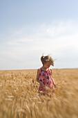 Girl Exploring Wheat Field