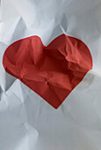 Crumpled Red Heart on Paper