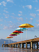Colourful umbrellas on a wooden jetty, Seebruck, Lake Chiemsee, Chiemgau, Bavaria, Germany