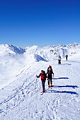 Group of people backcountry skiing ascending the mountain, Villgraten range in background, Marchkinkele, Villgraten range, Hohe Tauern range, East Tyrol, Austria, Europe