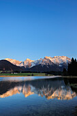 Snow- covered Karwendel range reflecting in a mountain lake, Kruen, Werdenfelser Land, Bavarian Alps, Upper Bavaria, Bavaria, Germany