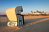 Beach chair and pier in the evening, Ahlbeck seaside resort, Usedom island, Baltic Sea, Mecklenburg-West Pomerania, Germany
