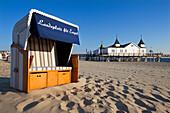 Beach chair and pier, Ahlbeck seaside resort, Usedom island, Baltic Sea, Mecklenburg-West Pomerania, Germany