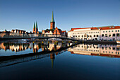 View over river Trave to old town with St. Mary' s church and church of St. Peter, Hanseatic City of Luebeck, Schleswig Holstein, Germany