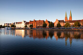 Old storehouses at Holsten harbour, St Mary´s church, Hanseatic city of Luebeck, Baltic Sea, Schleswig-Holstein, Germany