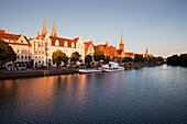 View over harbor to gabled houses, St. Mary' s church and church of St Peter, Hanseatic City of Luebeck, Schleswig-Holstein, Germany