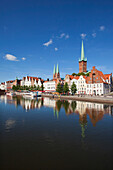 View over river Trave to old town with St Mary' s church and church of St. Peter, Hanseatic City of Luebeck, Schleswig Holstein, Germany