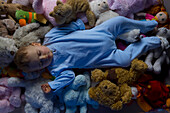 Baby sleeping on stuffed toys