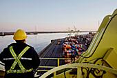 Worker on a crane, Montréal Harbour
