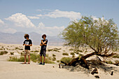 US, California, Death Valley, two teenagers boys