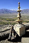 India, Jammu & Kashmir, Ladakh, Tikse Gompa tibetan buddhist monastery, roof ornament, trumpets, scenery
