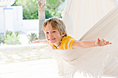 Boy playing in hammock