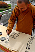 China, Shaanxi, Xian, Giant Wild Goose Pagoda, monk writing in a decorative hand