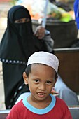 Malaysia, Kuala Lumpur, Kuala Lumpur, Young muslim boy and his mother.