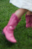 Blurred Girl Wearing Pink Boots on Lawn