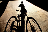 Human Shadow With Bicycle
