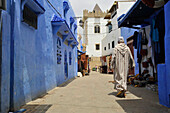 Man in traditional dress in the old town of Asilah, Atlantic Coast, Morocco, Africa