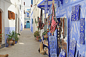 Blue paintings on the walls of a house and shop in the old town of Asilah, Atlantic Coast, Morocco, Africa