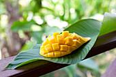 Sliced mango fruit on a banana leaf, Pai, Thailand, Asia