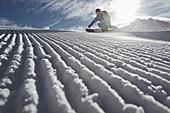 Female skier downhill skiing, Chandolin, Anniviers, Valais, Switzerland