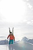 Female skier ascending through deep snow, Chandolin, Anniviers, Valais, Switzerland
