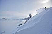 Snowboarder in deep snow, Hahnenkamm, Kitzbuehel, Tyrol, Austria