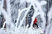 Man jogging through winter scenery, Irsee, Bavaria, Germany
