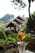 Drink with unusual flower decoration at a restaurant, Khao Sok National Park, Andaman Sea, Thailand